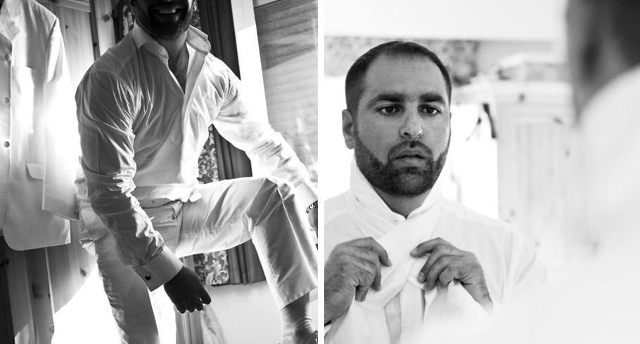 lo sposo indossa il suo abito di nozze